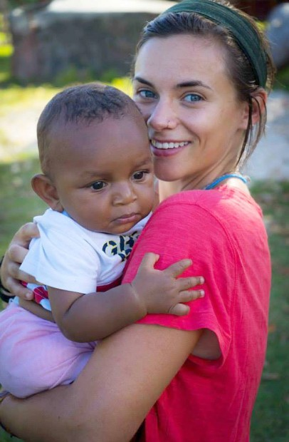 Laura holds a baby on Malekula, in Vanuatu, where she's working with the Peace Corps