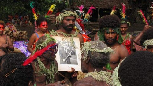 Tannese people with a photo of their divine Duke. Picture: SBS ONE