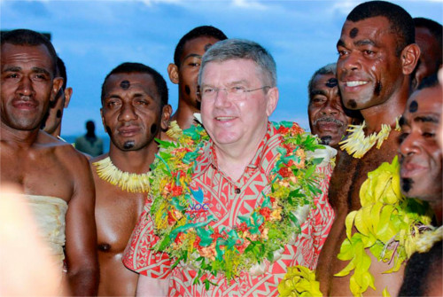 International Olympic Committee President Thomas Bach, center, poses for a photo with local men in Suva, Fiji, Saturday, May 2, 2015. Bach, addressing the Oceania National Olympic Committee meeting, has urged national and regional Olympic bodies to lobby their governments to...