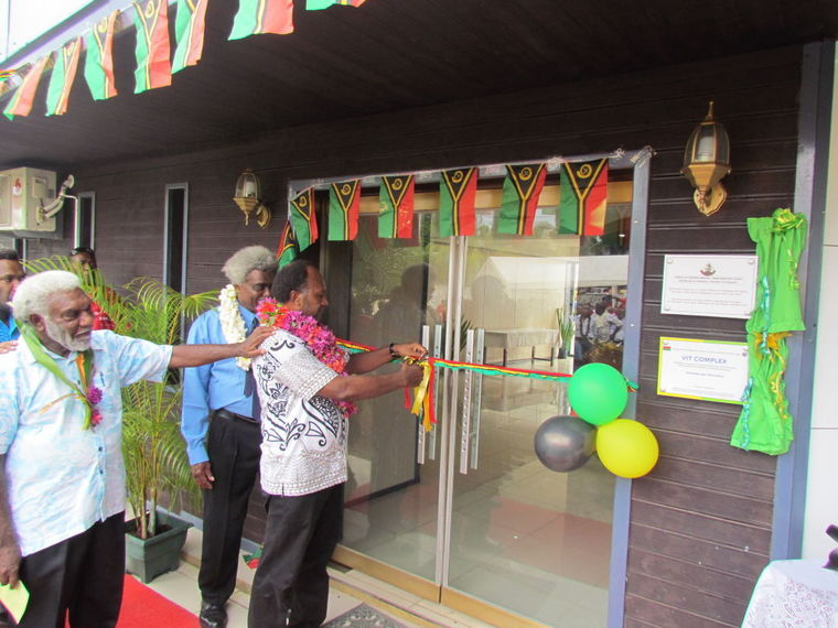 Prime Minister Salwai cutting the ribbon to officially open the temporary premises as his new Office