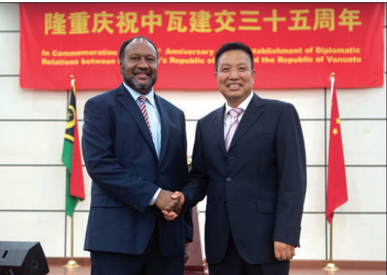 Vanuatu PM Charlot Salwai handshakes with Chinese President Xi Jinping