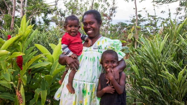 Denise Tatangis and her children in Mere Sau-wia, Nguna Island. Tatangis wants to offer homestay accommodation as another source of income.