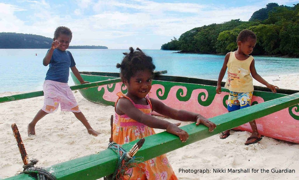 Children play on Champagne beach, Espiritu Santo, Vanuatu. A new study has found that the country's first people came from Asia rather than neighbouring Pacific countries. Photograph: Nikki Marshall for the Guardian