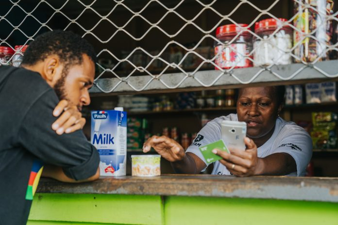 Pango-Vanuatu-Jamiesen-Kaltabang-pays-with-cryptocurrency-at-Loid-Alberts-store-during-the-Oxfam-Sempo-ConsenSys-led-Unblocked-Cash-Blockchain-pilot